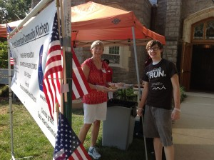 outside chris cox and university volunteer at barbecue